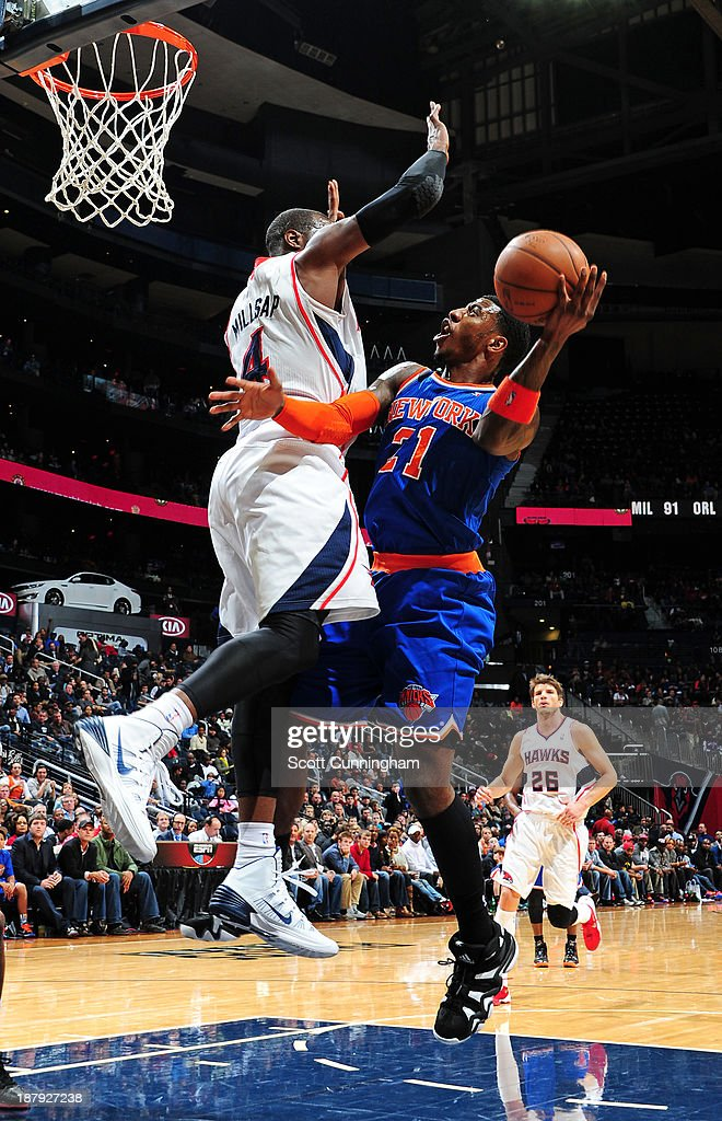 <a gi-track='captionPersonalityLinkClicked' href=/galleries/search?phrase=Iman+Shumpert&family=editorial&specificpeople=5042486 ng-click='$event.stopPropagation()'>Iman Shumpert</a> #21 of the New York Knicks shoots the bal against the Atlanta Hawks on November 13, 2013 at Philips Arena in Atlanta, Georgia.
