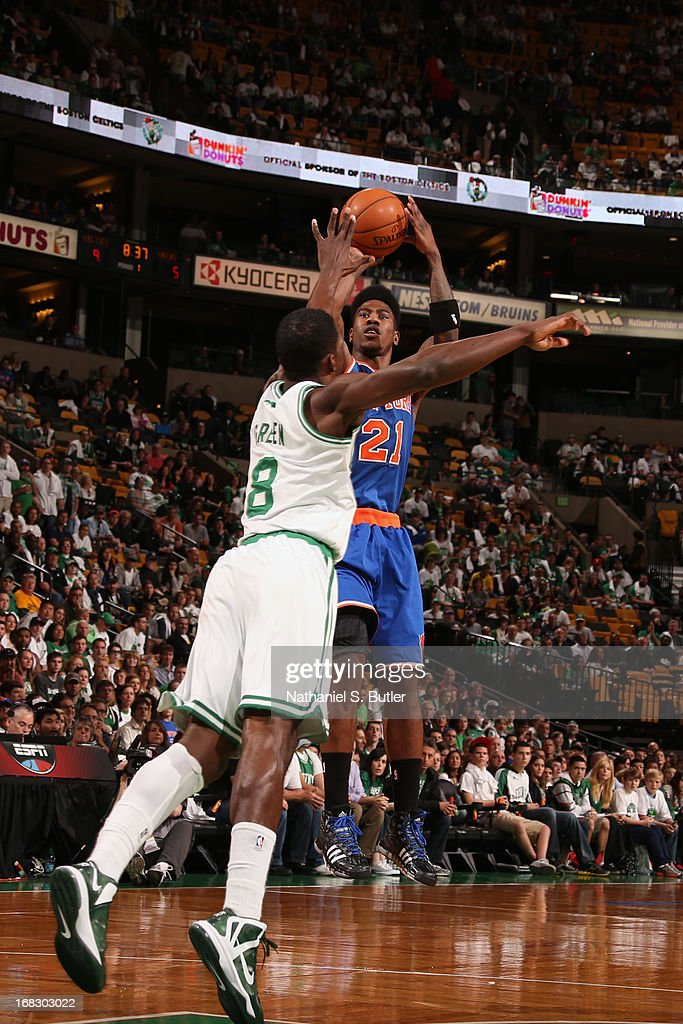 <a gi-track='captionPersonalityLinkClicked' href=/galleries/search?phrase=Iman+Shumpert&family=editorial&specificpeople=5042486 ng-click='$event.stopPropagation()'>Iman Shumpert</a> #21 of the New York Knicks takes a jump shot against Jeff Green #8 of the Boston Celtics in Game Four of the Eastern Conference Quarterfinals during the 2013 NBA Playoffs on April 28, 2013 at the TD Garden in Boston.