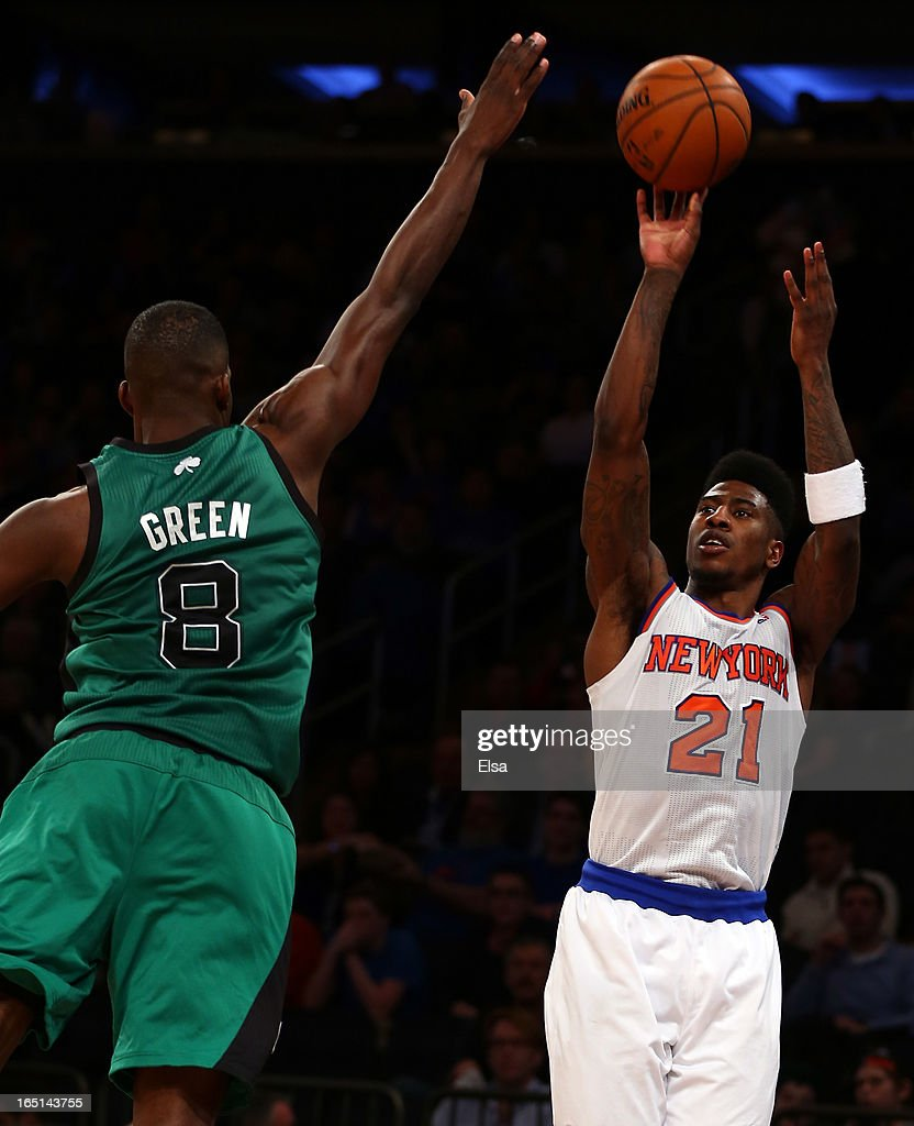 Iman Shumpert #21 of the New York Knicks takes a shot as Jeff Green #8 of the Boston Celtics defends on March 31, 2013 at Madison Square Garden in New York City.