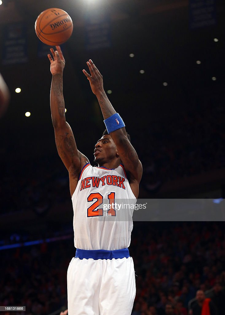 <a gi-track='captionPersonalityLinkClicked' href=/galleries/search?phrase=Iman+Shumpert&family=editorial&specificpeople=5042486 ng-click='$event.stopPropagation()'>Iman Shumpert</a> #21 of the New York Knicks takes a shot in the second half against the Indiana Pacers during Game One of the Eastern Conference Semifinals of the 2013 NBA Playoffs on May 5, 2013 at Madison Square Garden in New York City. The Indiana Pacers defeated the New York Knicks 102-95.