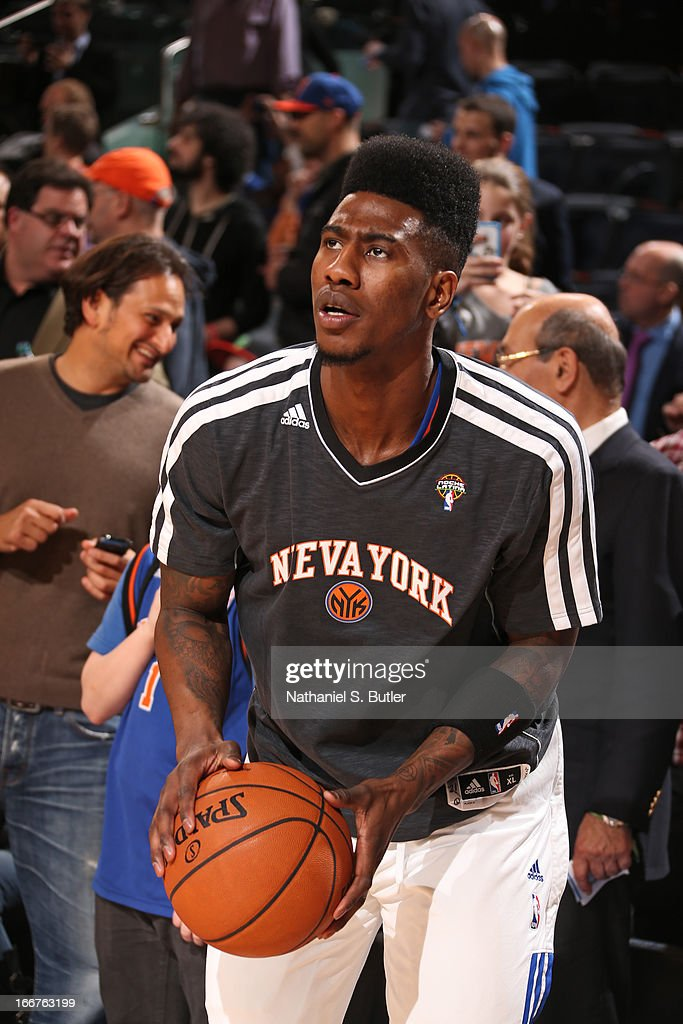 <a gi-track='captionPersonalityLinkClicked' href=/galleries/search?phrase=Iman+Shumpert&family=editorial&specificpeople=5042486 ng-click='$event.stopPropagation()'>Iman Shumpert</a> #21 of the New York Knicks warms up before the game against the Oklahoma City Thunder on March 7, 2013 at Madison Square Garden in New York City.
