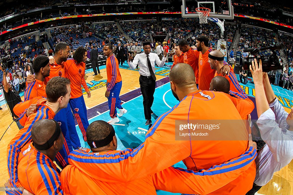 Iman Shumpert #21 of the New York Knicks, wearing street clothes, leads his team in a huddle before a game against the New Orleans Hornets on November 20, 2012 at the New Orleans Arena in New Orleans, Louisiana.