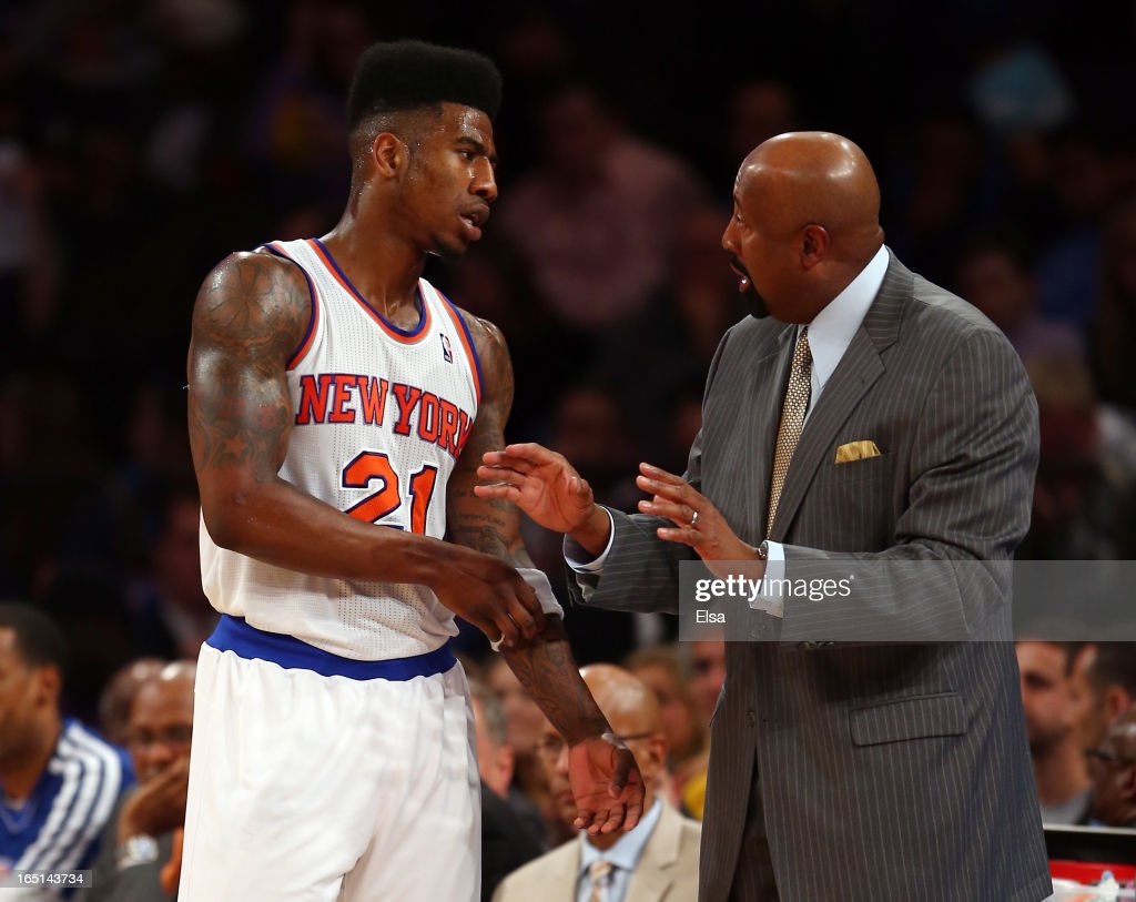 Iman Shumpert #21 talks with head coach Mike Woodson of the New York Knicks during a time out against the Boston Celtics on March 31, 2013 at Madison Square Garden in New York City.