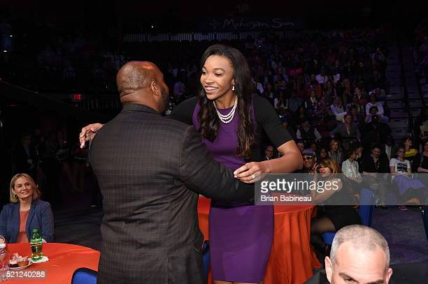 Imani Boyette hugs a family member after being drafted number ten overall by the Chicago Sky during the 2016 WNBA Draft Presented By State Farm on...