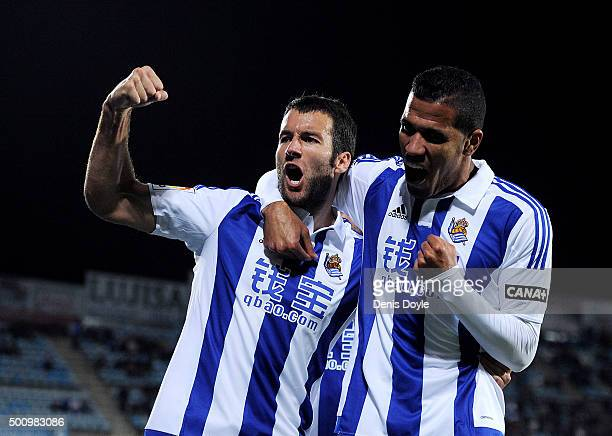 Imanol Agirretxe of Real Sociedad celebrates with Jonathas after scoring his team's opening goal during the La Liga match between Getafe CF and Real...