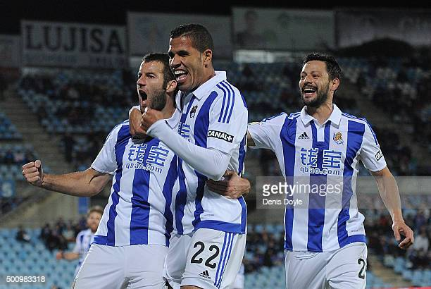 Imanol Agirretxe of Real Sociedad celebrates with Jonathas and Carlos Martinez after scoring his team's opening goal during the La Liga match between...