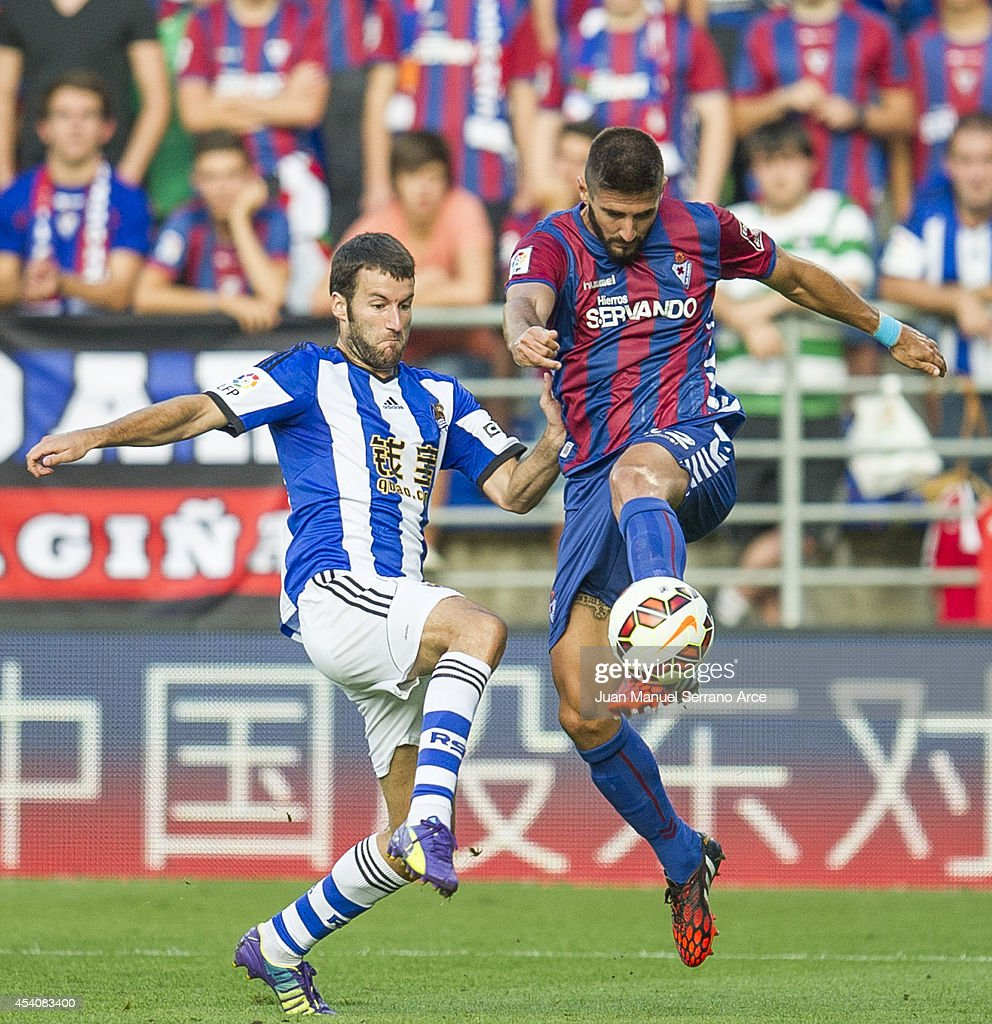 Imanol Agirretxe of Real Sociedad duels for the ball with Raul Rodriguez of SD Eibar during the La Liga match between SD Eibar and Real Sociedad at Ipurua Municipal Stadium on August 24, 2014 in Eibar, Spain.