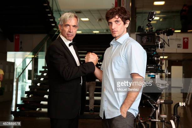 Imanol Arias and Quim Gutierrez pose on the set of their latest movie 'Anacleto Agente Secreto' being filmed at the Palau de Congressos Fira de...