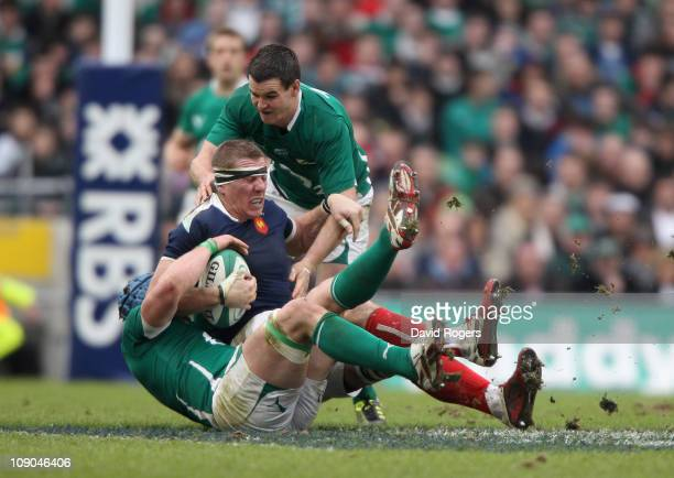 Imanol Harinordoquy of France is tackled by Sean O'Brien and Jonathan Sexton during the RBS 6 Nations match between Ireland and France at the Aviva...