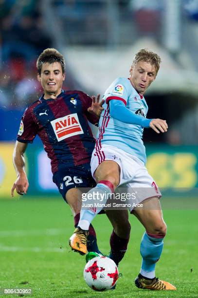 Imanol Sarriegui of SD Eibar duels for the ball with Daniel Wass of RC Celta de Vigo during the Copa Del Rey match between Eibar and RC Celta de Vigo...