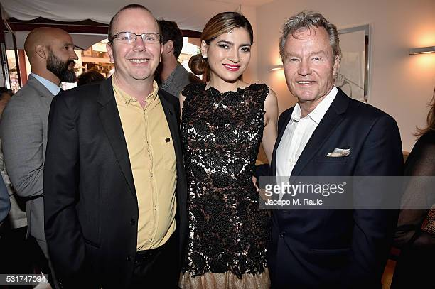 IMDb CEO Founder Col Needham Bianca Blanco and actor John Savage attend IMDb's 2016 Dinner Party In Cannes at Restaurant Mantel on May 16 2016 in...
