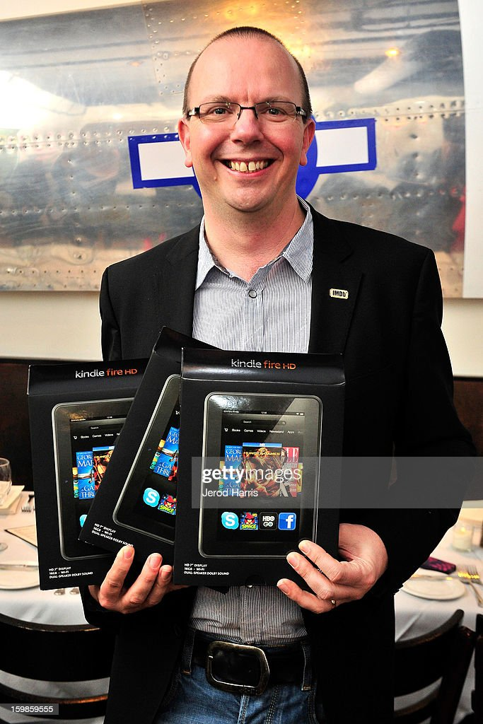 IMDb founder Col Needham holds Amazon's Kindle Fire HD featuring IMDb's X-Ray for movies at the IMDb Sundance dinner party at The Mustang on January 21, 2013 in Park City, Utah.