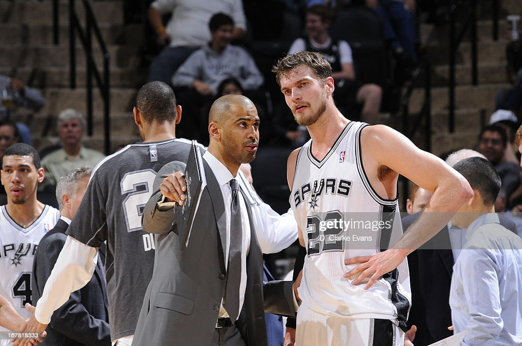 <a gi-track='captionPersonalityLinkClicked' href=/galleries/search?phrase=Ime+Udoka&family=editorial&specificpeople=240486 ng-click='$event.stopPropagation()'>Ime Udoka</a>, assistant coach of the San Antonio Spurs, instructs <a gi-track='captionPersonalityLinkClicked' href=/galleries/search?phrase=Tiago+Splitter&family=editorial&specificpeople=208218 ng-click='$event.stopPropagation()'>Tiago Splitter</a> #22 during the game against the Orlando Magic on April 3, 2013 at the AT&T Center in San Antonio, Texas.