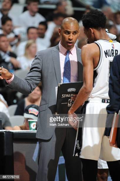 Ime Udoka coaches Dejounte Murray of the San Antonio Spurs in Game Three of the Western Conference Finals against the Golden State Warriors during...