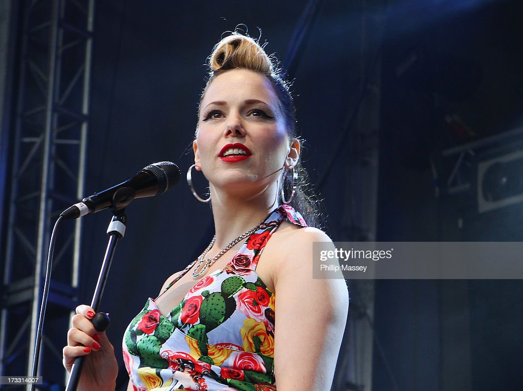 <a gi-track='captionPersonalityLinkClicked' href=/galleries/search?phrase=Imelda+May&family=editorial&specificpeople=5401061 ng-click='$event.stopPropagation()'>Imelda May</a> performs at Iveagh Gardens on July 11, 2013 in Dublin, Ireland.