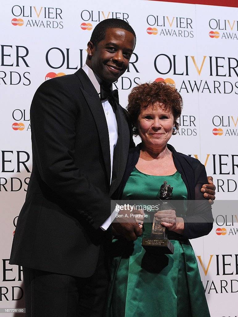 Imelda Staunton with ther Best Actress in a Musical award with presenter Adrian Lester during The Laurence Olivier Awards at the Royal Opera House on April 28, 2013 in London, England.