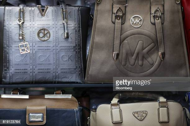 Imitation bags sits on display at a leather goods store in the Dharavi area of Mumbai India on Tuesday July 18 2017 India's new goods and services...