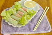 imitation crab stick and green oak wrapped flour paste dipping cream sauce on white plate