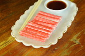 imitation crab stick made from fish with soy sauce on plate