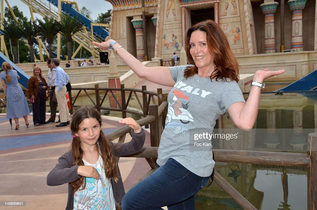 Imitator/voice for 'The Guignols de L' Info' Sandrine Alexis (R) and her daughter attend the 'Oziriz' New Game Launch at the Parc Asterix on June 2, 2012 in Paris, France.