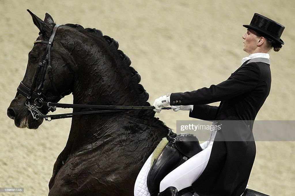 Imke Schellekens-Bartels from The Netherlands with Toots compete during the World Cup dressage at the Jumping Amsterdam, on January 18, 2013 in Amsterdam. AFP PHOTO/ANP/ BAS CZERWINSKI netherlands out