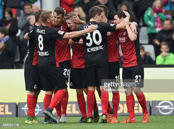 Immanuel Hoehn of Freiburg celebrates with his teammates after scoring his team's first goal during the Second Bundesliga match between SC Freiburg...