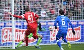 Immanuel Hoehn of SC Freiburg socres the opening goal against Sebastian Rudy and Oliver Baumann of 1899 Hoffenheim during the Bundesliga match...