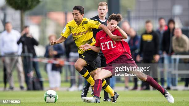 Immanuel Pherai of Dortmund and Can Karaguemrueklue of Koeln fight for the ball during the B Juniors Bundesliga match between Borussia Dortmund and...
