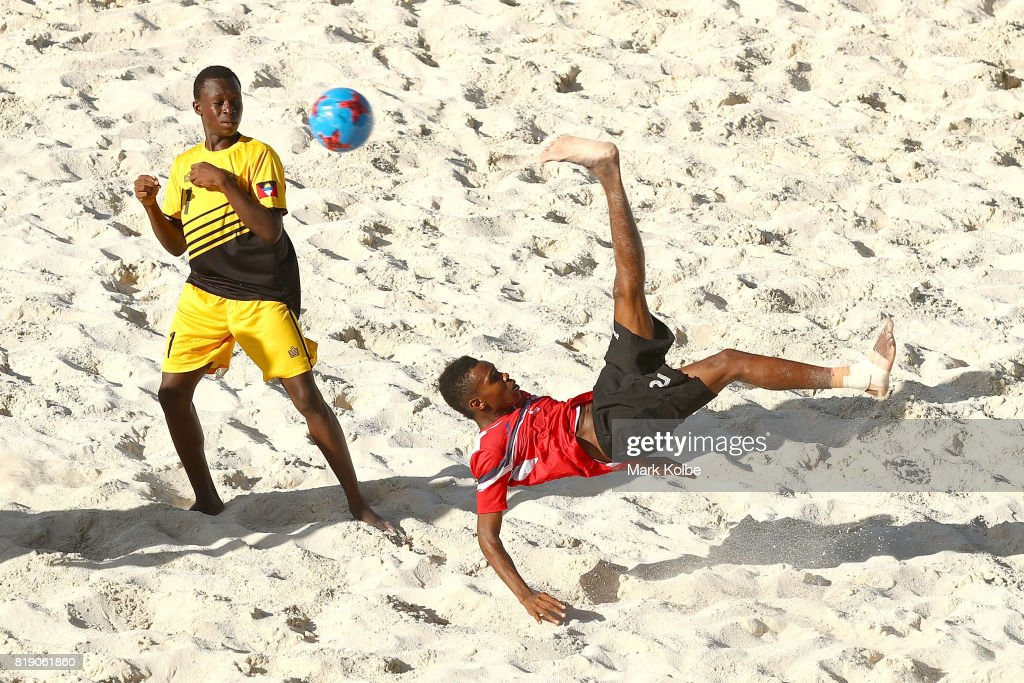 Immanuel Russell of Trinidad & Tobago shoots at goal with an overhead kick during the Beach Soccer match 2 between Trinidad & Tobago and Antigua & Barbuda on day 2 of the 2017 Youth Commonwealth Games at QE Sports Centre on July 19, 2017 in Nassau, Bahamas.