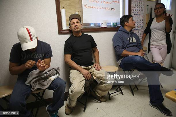 Immigrant day laborers sit inside Bay Parkway Community Job Center on September 28 2013 in the Brooklyn borough of New York City The center part of...