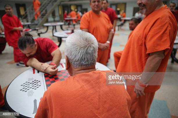 Immigrant detainees talk while in a general population block at the Adelanto Detention Facility on November 15 2013 in Adelanto California The...