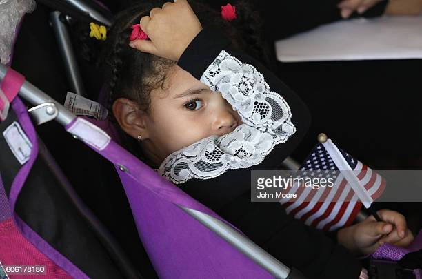 Immigrant families take part in a naturalization ceremony on Ellis Island on September 16 2016 in New York City The ceremony marked US Constitution...