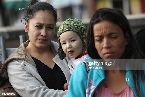 Immigrant families wait at a Catholic Charities sponsored 'immigrant respite center' before taking a bus from the border into the interior of the...