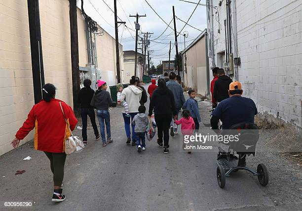 Immigrant families walk to a Catholicrun 'immigrant respite center' before taking a bus from the border into the interior of the United States on...