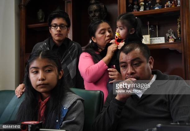 Immigrant Mario Vargas waits with his wife Lola and their daughter Athena in their attorney's office before the deportation hearing of Mario in Los...