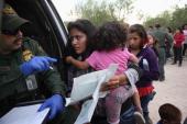 Immigrant Melida Patricio Castro from Honduras shows a birth certificate for her daughter Maria Celeste to a US Border Patrol agent near the USMexico...