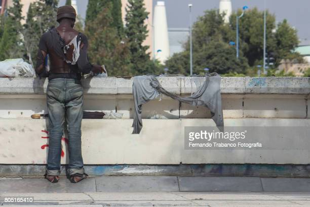 Immigrant refugee alone in the street of the city