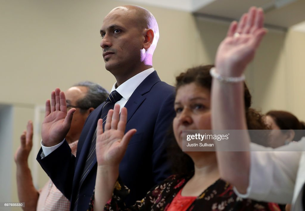 Immigrant refugees are sworn in as U.S. citizens during a naturalization ceremony on June 19, 2017 in San Francisco, California. 29 former refugees from 17 different countries were sworn in as Americaan citizens during a ceremony to mark World Refugee Day. World Refugee Day is Tuesday, June 20.