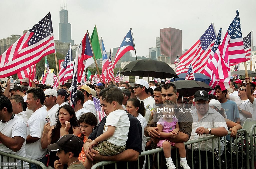 Immigrant rights demonstrators gather in Grant Park for a rally following a march July 19, 2006 in Chicago, Illinois. About 10,000 people marched from the city?s west side, through downtown, to Grant Park calling for a halt to deportations while Congress works on an immigration reform package.