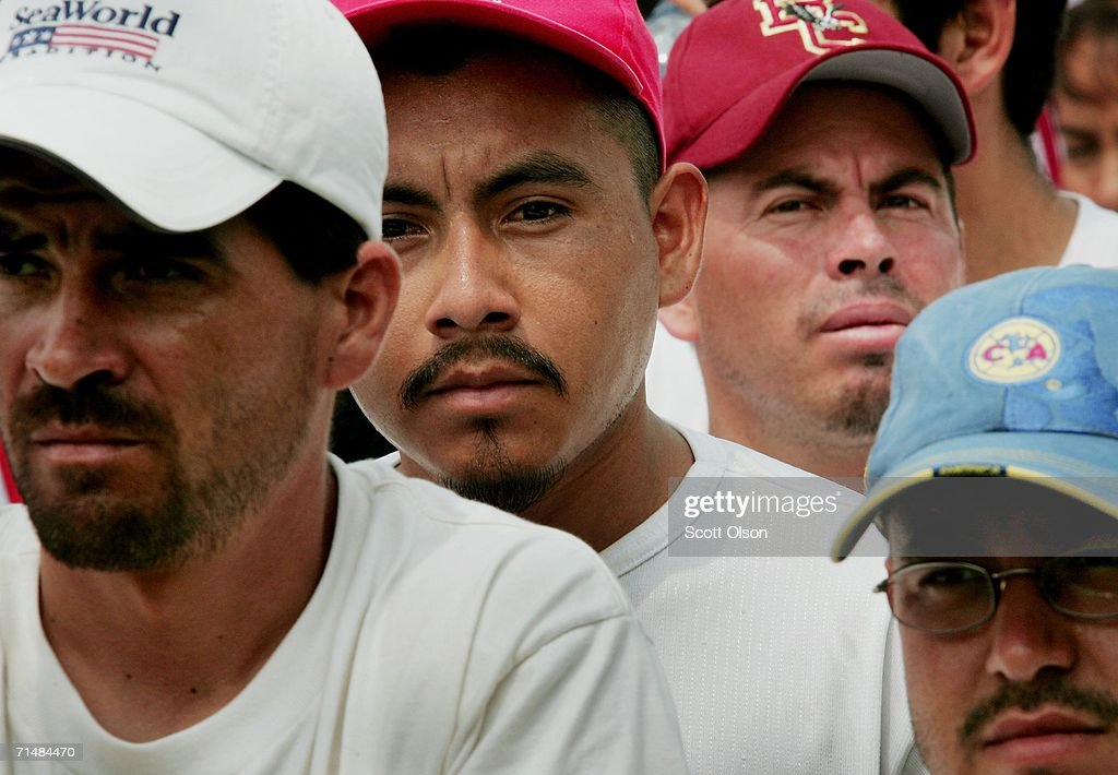 Immigrant rights demonstrators listen to speakers at a rally in Grant Park following a march July 19, 2006 in Chicago, Illinois. About 10,000 people marched from the city?s west side, through downtown, to Grant Park calling for a halt to deportations while Congress works on an immigration reform package.