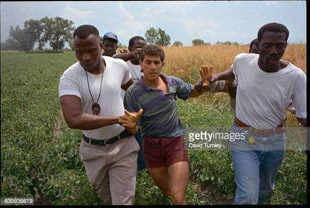 Immigrant Workers Capturing a Thief