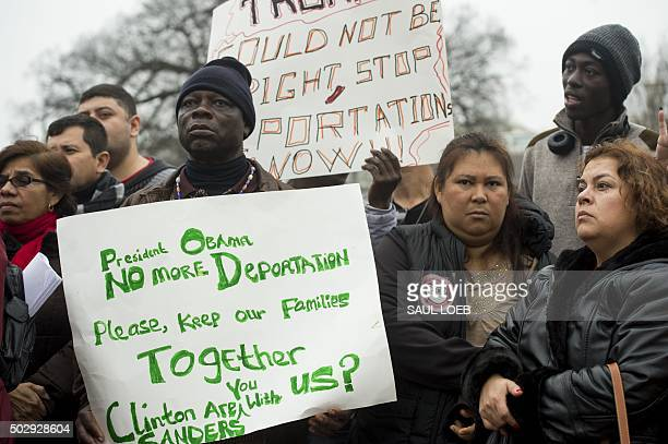 Immigrants and their supporters with the group 'We are CASA' protest against planned raids to deport undocumented illegal immigrants during a rally...