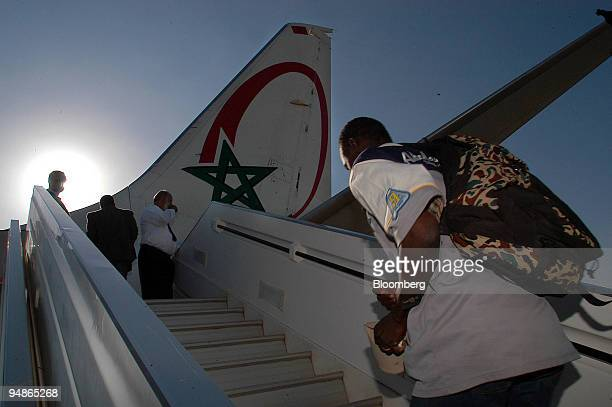 Immigrants are seen boarding a Malibound Royal Air Maroc plane the first repatriation flight issued by the Moroccan government at the OujdaAngad...