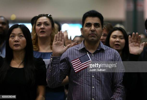 Immigrants are sworn in as US citizens during a naturalization ceremony held by US Citizenship and Immigration Services at the Los Angeles Convention...