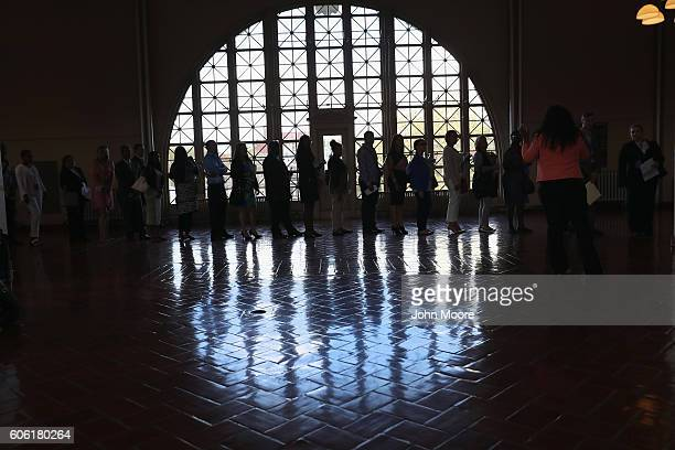 Immigrants arrive to Ellis Island for a naturalization ceremony on September 16 2016 in New York City The ceremony marked US Constitution and...