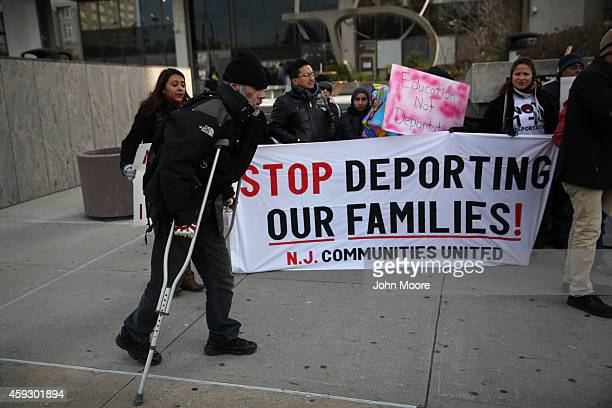 Immigrants attend a press conference for families facing deportation on November 20 2014 in Newark New Jersey They called on President Obama to...