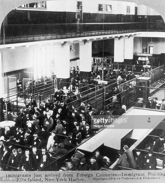 Immigrants await medical examination at the Immigration Building on Ellis Island New York before being allowed into the United States 1904