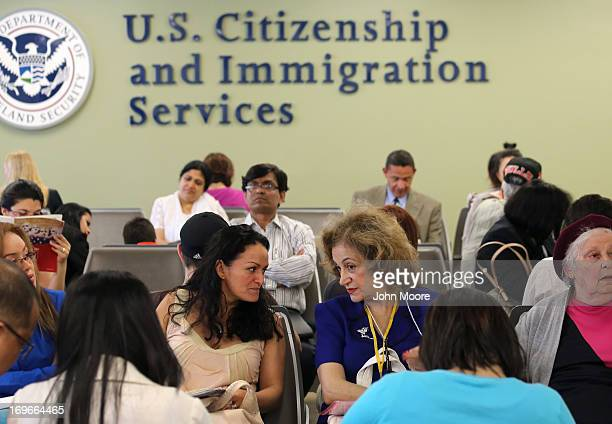 Immigrants await their turn for green card and citizenship interviews at the US Citizenship and Immigration Services Queens office on May 30 2013 in...