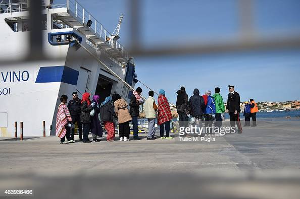 Immigrants board a ship on February 20 2015 in Lampedusa Italy Hundreds of migrants recently arrived in Lampedusa after fleeing the attacks by ISIS...