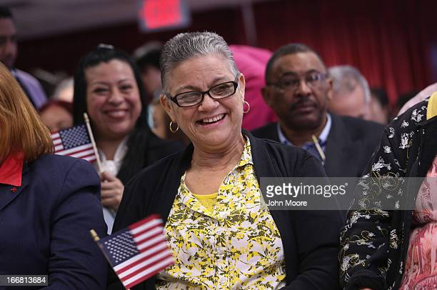 Immigrants celebrate after taking the oath of American citizenship at a naturalization ceremony on April 17 2013 in New York City Fifty immigrants...